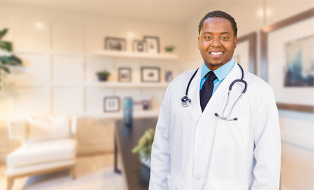 Young African American Doctor or Nurse Standing in His Office. photo