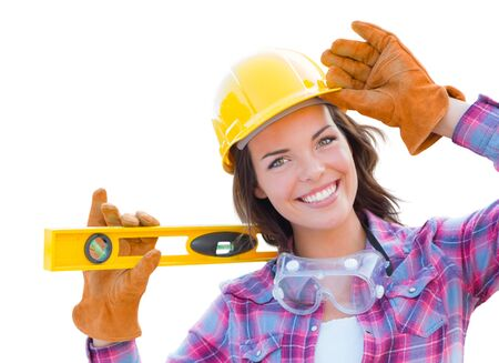 Young Attractive Female Construction Worker with Level Wearing Gloves, Hard Hat and Protective Goggles Isolated On White.