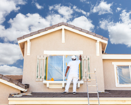 shutter: Professional House Painter Painting the Trim And Shutters of A Home.
