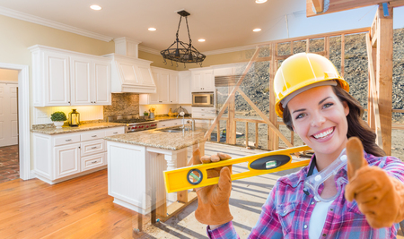 Female Construction Worker In Front of House Framing Gradating to Finished Kitchen Photo. photo