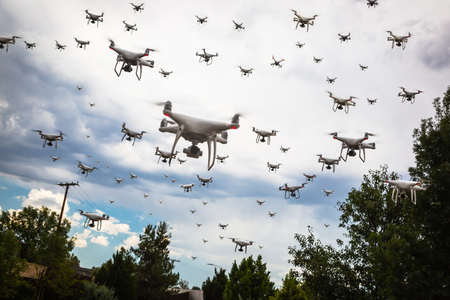 Dozens of Drones Swarm in the Cloudy Sky. Banque d'images