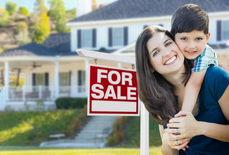 Young Mother and Son In Front of For Sale Real Estate Sign and House. Stok Fotoğraf