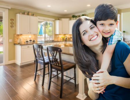 Young Mother and Son Inside Beautiful Custom Kitchen. Stok Fotoğraf