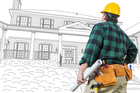 Male Contractor with Hard Hat and Tool Belt Looking At Custom House Drawing On White. Stock Photo