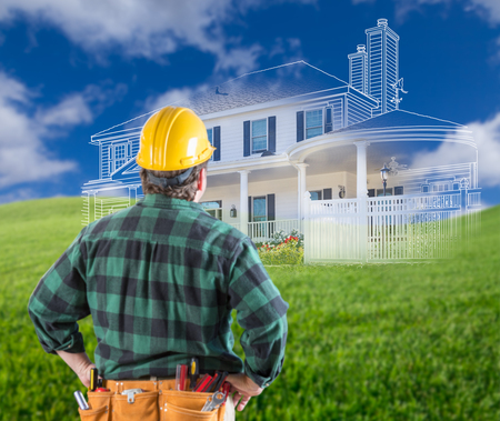 Contractor Standing Outdoors Looking Over Grass Site with Ghosted House.