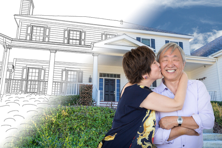 Chinese Senior Adult Couple Kissing In Front Of Custom House Drawing and Photo Transition. Stock Photo