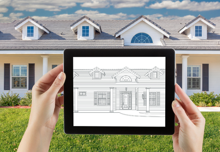 Female Hands Holding Computer Tablet with House Drawing on Screen