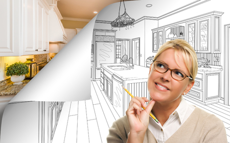 Woman Facing Kitchen Drawing Page Corner Flipping with Photo Behind. Banco de Imagens