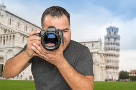 Hispanic Male Photographer With Camera at Leaning Tower of Pisa.