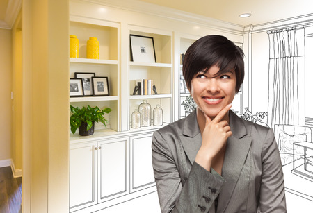 Young Woman Over Custom Built-in Shelves and Cabinets Design Drawing Gradating to Finished Photo. Stockfoto