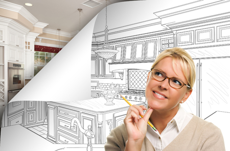 Woman Facing Kitchen Drawing Page Corner Flipping with Photo Behind. Stock Photo