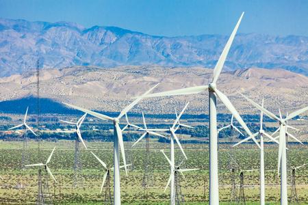 Dramatic wind turbine farm in the desert of California. Banco de Imagens