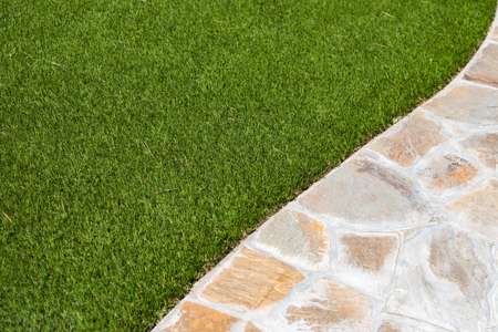 New Artificial Grass Installed Near Walkway. Foto de archivo - 104591455