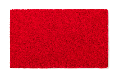 Blank Red Welcome Mat Isolated on White Background Ready For Your Own Text. Stock Photo