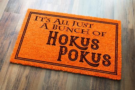 Its All A Bunch Of Hokus Pokus Halloween Orange Welcome Mat On Wood Floor Background.