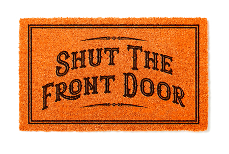 Shut The Front Door Halloween Orange Welcome Mat Isolated on White Background.