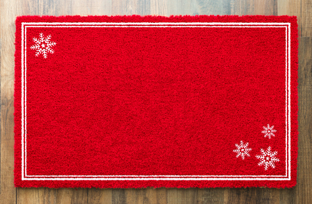 Blank Holiday Red Welcome Mat With Snow Flakes On Wood Floor Background.
