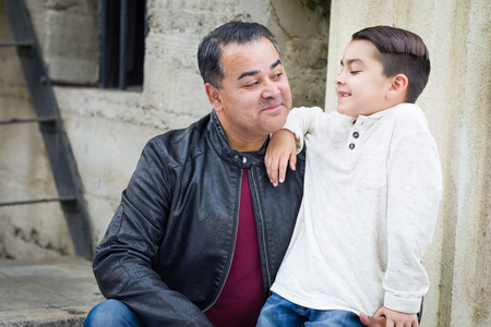 Portrait of Mixed Race Hispanic and Caucasian Son and Father Stock Photo