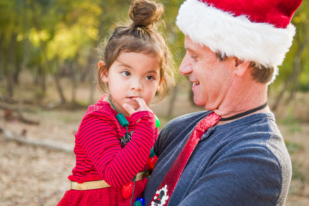 Festive Grandfather and Mixed Race Baby Girl Outdoors.