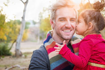 Handsome Caucasian Young Man with Mixed Race Baby Girl Outdoors. Stock Photo
