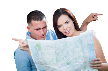 Young Lost and Confused Military Couple Looking at Map Isolated on White. 免版税图像
