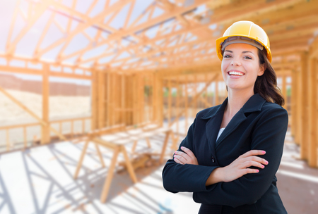 Smiling Female Contractor In Hard Hat At Construction Site.