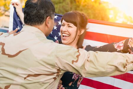 Excited Woman With American Flag Runs to Male Military Soldier Returning Home.