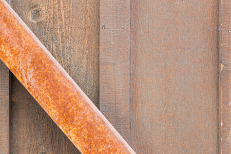 Wooden Wall with Rusty Metal Beam Background.