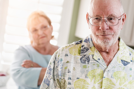 Senior Adult Couple in Dispute or Consoling in Kitchen of House. Stock Photo