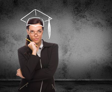 Graduation Cap Drawn on Head of Young Adult Woman with Pencil In Front of Wall with Copy Space.
