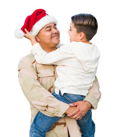 Hispanic Male Soldier Wearing Santa Cap Holding Mixed Race Son Isolated on a White Background. Stock Photo