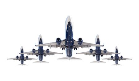 Five Passenger Airplanes In Formation Isolated on a White Background. Stock Photo
