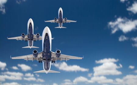 Bottom View of Three Passenger Airplanes Flying In The Blue Sky.
