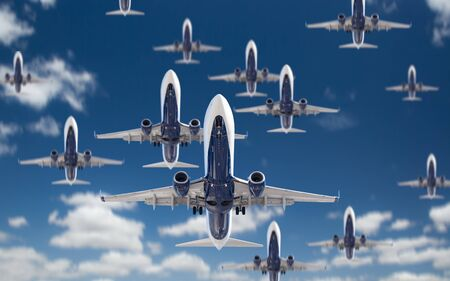 Bottom View of Several Passenger Airplanes Flying In The Blue Sky.