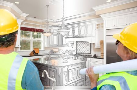 Male and Female Contractors Overlooking Kitchen Drawing Transition to Completed Project.