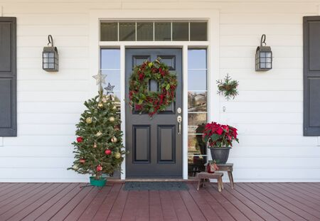 Christmas Decorations At Front Door of House. Stock Photo