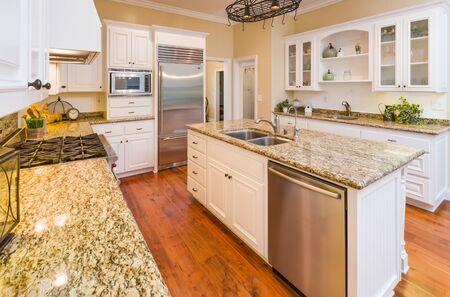 Beautiful Custom Kitchen Interior With Hard Wood Floors.
