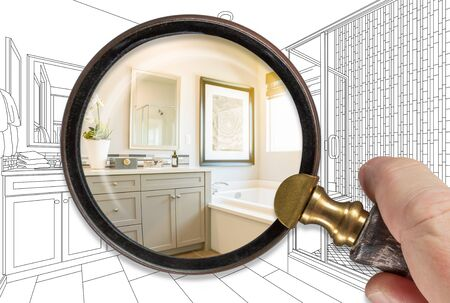 Hand Holding Magnifying Glass Revealing Finished Bathroom Build Over Drawing.