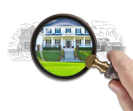 Hand Holding Magnifying Glass Revealing Finished House Build Over Drawing. Stockfoto