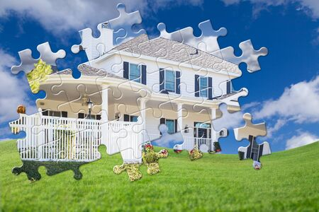 Puzzle Pieces Fitting Together Revealing Finished House Build Over Grass Field. Stockfoto