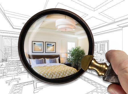 Hand Holding Magnifying Glass Revealing Finished Master Bedroom Over Drawing.
