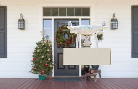 Drone Delivering Package to Christmas Decorated House Porch.