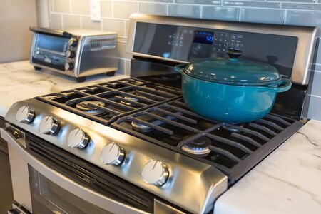 Beautiful Kitchen Stove with Cooking Pot and Toaster Oven.
