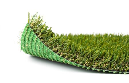 Flipped Up Section of Artificial Turf Grass On White Background.