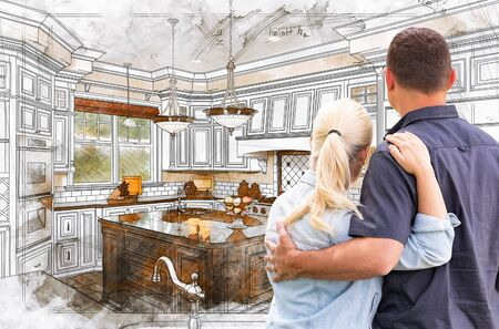 Young Adult Couple Facing Custom Kitchen Drawing Design Details. Stok Fotoğraf