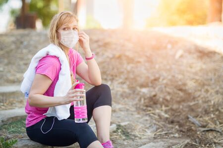 Girl Wearing Medical Face Mask During Workout Outdoors.