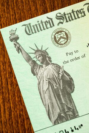 United States Internal Revenue Service, IRS, Check On Desk. Фото со стока