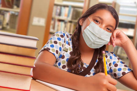 Hispanic Girl Student Wearing Face Mask Studying in Library.