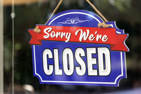 Storefront Closed Sign Through Window.