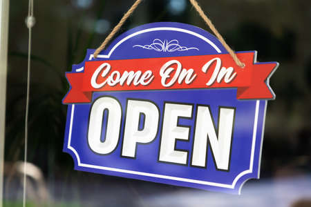 Storefront Open Sign Through Window.
